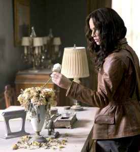 Katniss discovers a white rose, which unlike the other flowers has not wilted. It's a message from President Snow, who cultivates the flower to mask the smell of blood. Flowers are ephemeral, symbolizing the hope of beauty. Now they have become ominous, unnaturally enduring.